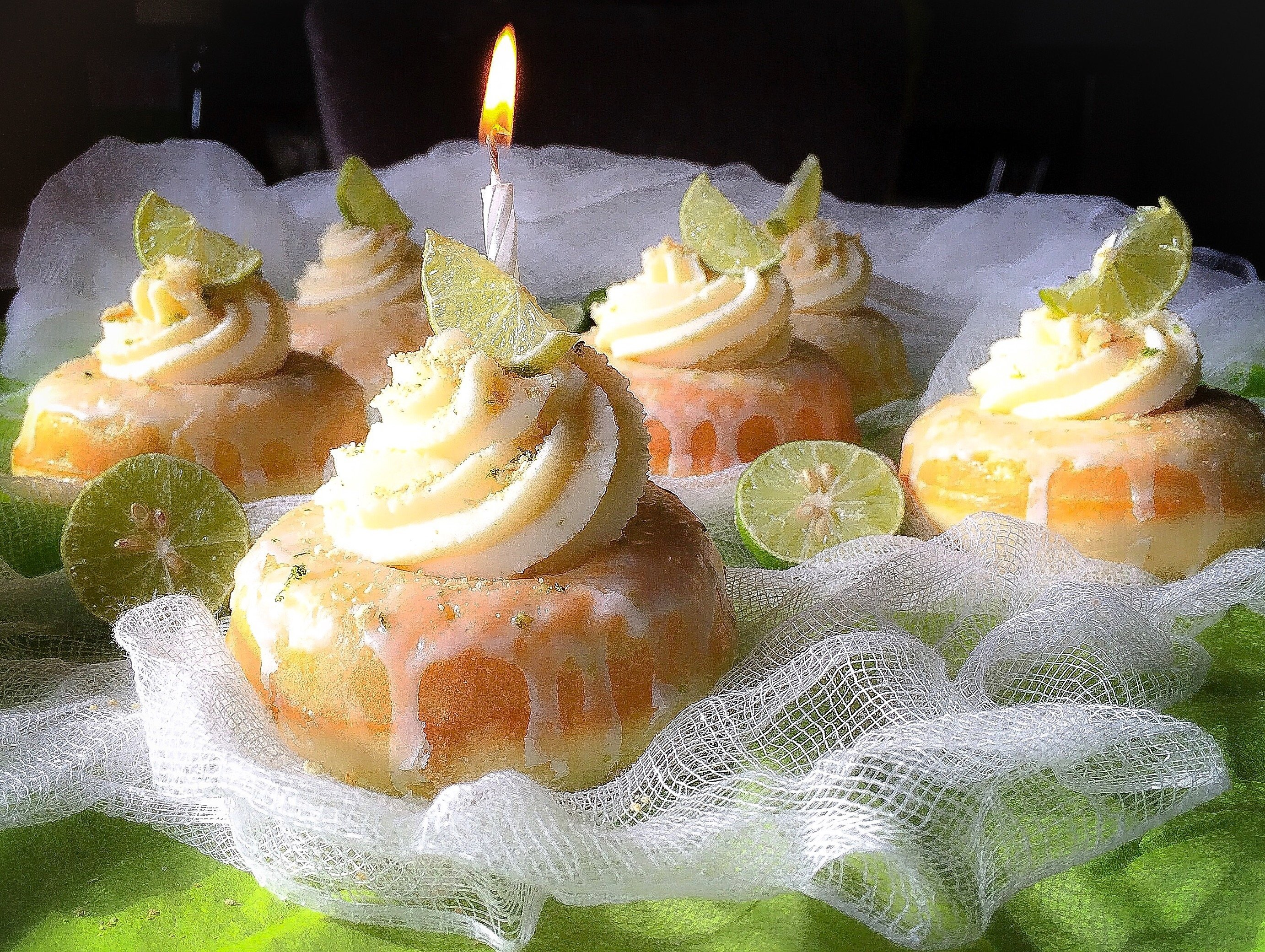 Julie's Key Lime Birthday Cake Glazed Donuts topped with a Key Lime Mascarpone Cream Frosting
