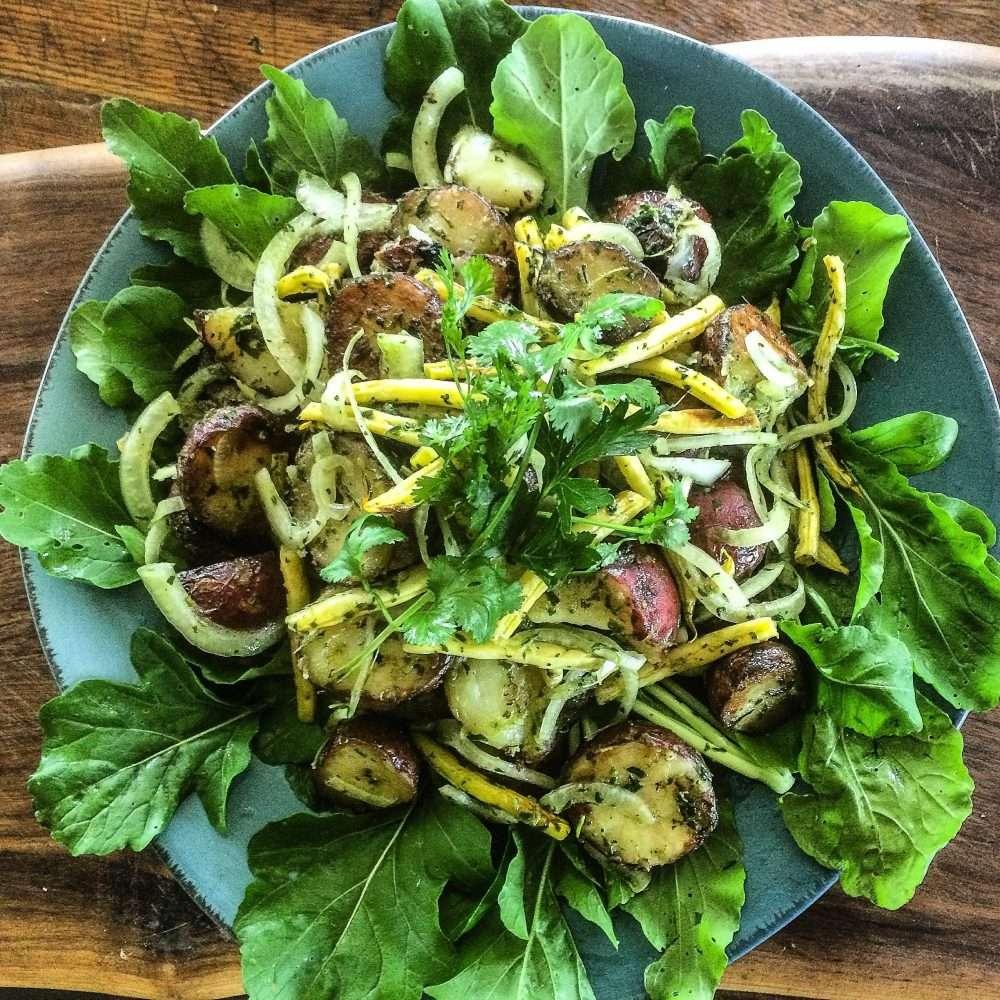 Grilled Yellow Bean and Potato Salad Dressed with a Fresh Herb Pesto on Arugula www.dailytiramisu.com