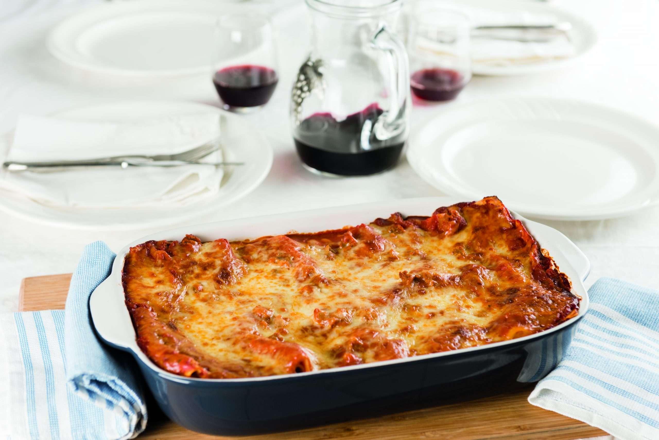 Sausage stuffed lasagna available at daily tiramisu blog by Julie Miguel